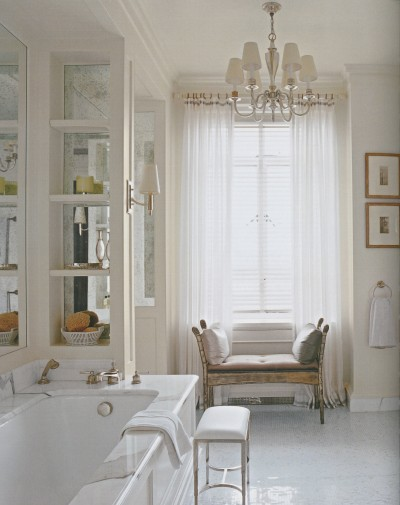 The natural light streaming in this bath makes it feel so warm. I love the idea of a decorative chandelier in the bath especially if it has tall ceilings.