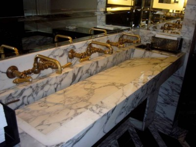 Reminiscent of grade school bathrooms, Cecconi's ladies room with 3 unlaquered brass fittings and a custom marble trough sink is charming and different.