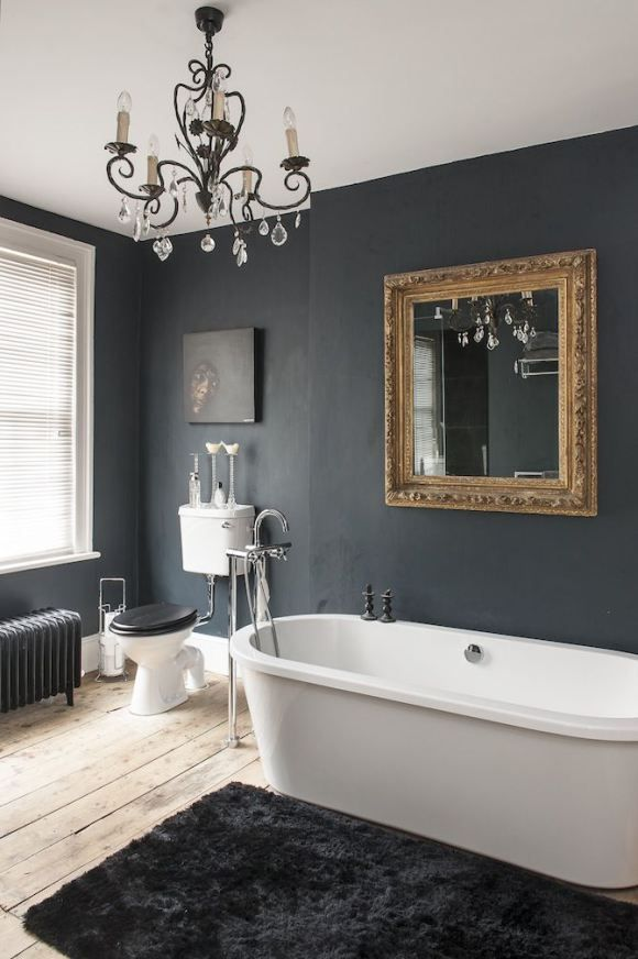 A lovely, warm and subdued nearly dark paint makes this bath warm and inviting.