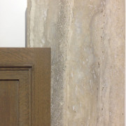 Beautiful beige and gray vein cut travertine with a mid tone wood cabinet. This is a classic and timeless look. It is both warm and sophisticated.
