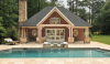 A more formal pool house that clearly mimics the architecture of the main house.