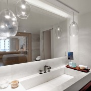 One Hotel Miami has installed pendants in their well designed baths. Their reflection in the mirror adds dimension to an already ample space..